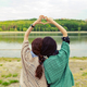 Best friends showing heart sign over beautiful landscape on the - PhotoDune Item for Sale