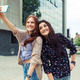 Two girls making funny selfie on the street, having fun together - PhotoDune Item for Sale