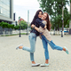 Carefree smiling sisters hugging and having fun together - PhotoDune Item for Sale