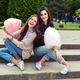 Two cheerful girls having fun with cotton candy outdoor - PhotoDune Item for Sale