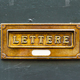 Free Download Close-Up Brushed Copper Letter Box on old painted wood Nulled