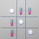 Game of the three in a row with tablets and capsules, conceptual image - PhotoDune Item for Sale