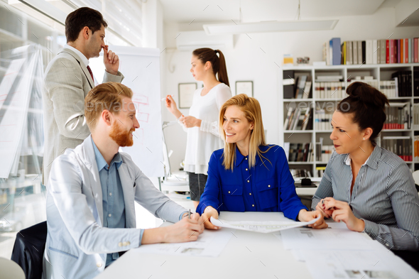 Group of business people working as team in office - Stock Photo - Images