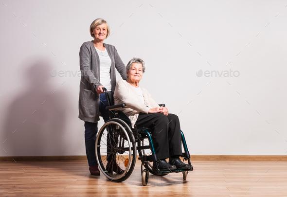 Studio portrait of a senior women in wheelchair. - Stock Photo - Images