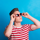 Free Download A young man with red sunglasses standing in a studio, looking up. Nulled