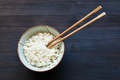 chopsticks in bowl with boiled rice on dark - PhotoDune Item for Sale