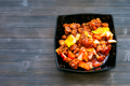 Pork in sweet and sour sauce in bowl on dark board - PhotoDune Item for Sale