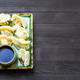 Dumplings on plate on dark table with copyspace - PhotoDune Item for Sale