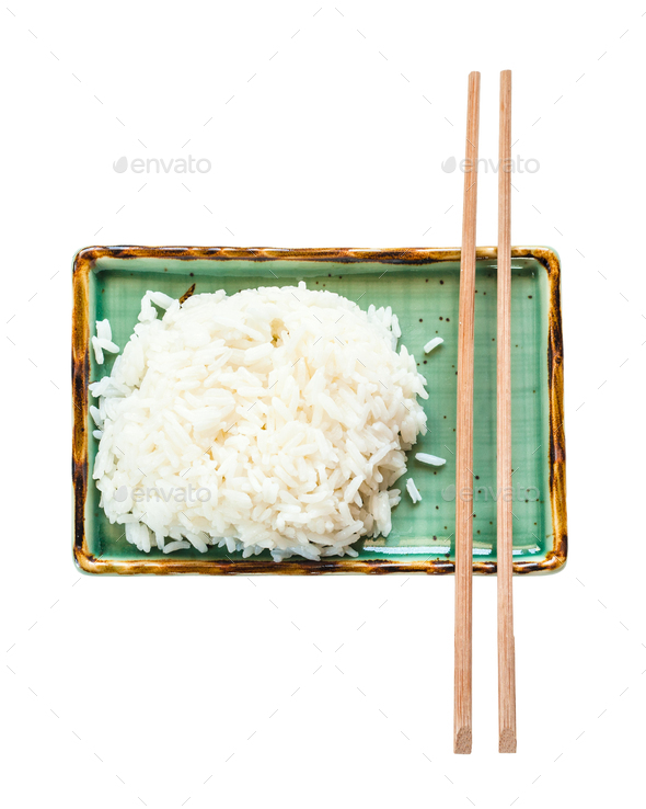 boiled rice and chopsticks on green plate isolated - Stock Photo - Images