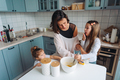 Happy family cook together in the kitchen - PhotoDune Item for Sale