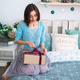 Girl sitting in bed with present box - PhotoDune Item for Sale