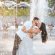Handsome guy and beautiful girls kissing on the background of a fountain - PhotoDune Item for Sale