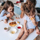 Mom and two daughters eat pancakes - PhotoDune Item for Sale