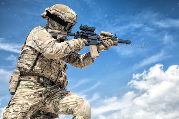 Equipped airsoft player aiming with service rifle - Stock Photo - Images