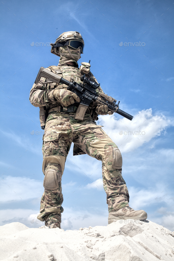 Airsoft player witt gun taking part in war games - Stock Photo - Images