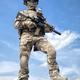 Airsoft player witt gun taking part in war games - PhotoDune Item for Sale