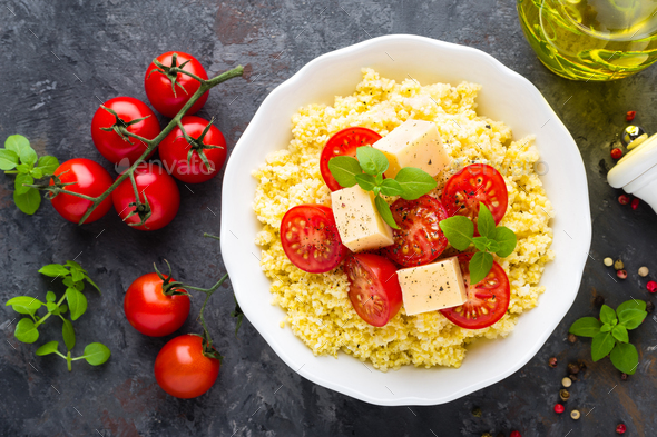 Millet porridge with tomatoes and cheese - Stock Photo - Images
