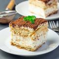 Piece of traditional italian Tiramisu dessert cake on a white pl - PhotoDune Item for Sale