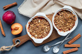 Plum crumble pie or plum crisp with oats and spices, in baking d - PhotoDune Item for Sale