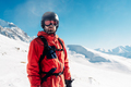 serious snowboarder is standing in the red suit - PhotoDune Item for Sale