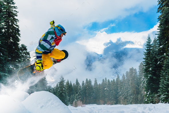 snowboarder is jumping very high - Stock Photo - Images