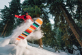 snowboarder with special equipment is riding and jumping very fast in the mountain forest - PhotoDune Item for Sale