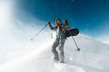 sportsman go with snowboard equipment in the snowstorm - PhotoDune Item for Sale