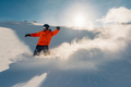 snowboarder is riding from snow hill - PhotoDune Item for Sale