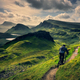 Mountain biker riding through rough mountain landscape of Quiraing, Scotland - PhotoDune Item for Sale
