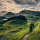 Mountain biker riding through rough mountain landscape of Quiraing, Scotland - PhotoDune Item for Sale