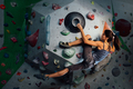 girl is climbing on the wall in the training room - PhotoDune Item for Sale