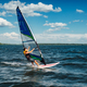 the athlete rides the windsurf over the waves on the lake - PhotoDune Item for Sale