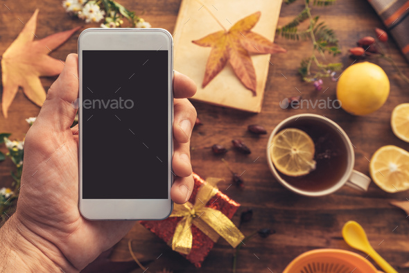 Smartphone mock up with autumn season decoration - Stock Photo - Images