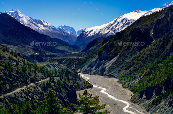 Himalayas mountain river valley with peaks in background - Stock Photo - Images