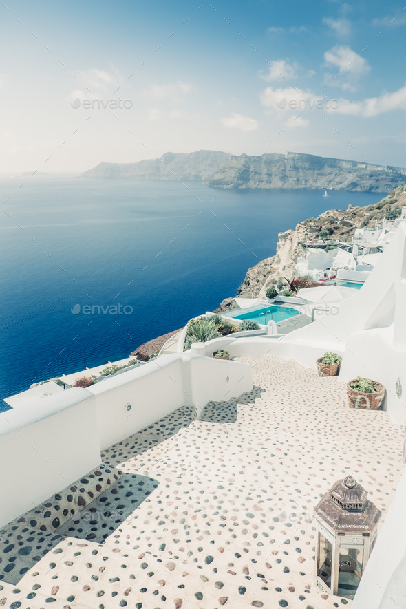 Scenic view of bright houses and pathway in romantic cycladic village, Greece - Stock Photo - Images