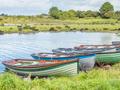 Boats Near Annaghkeen Pier in Ireland - PhotoDune Item for Sale