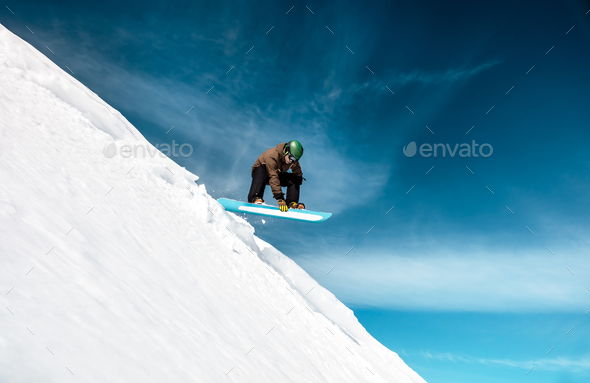Active man snowboarding - Stock Photo - Images