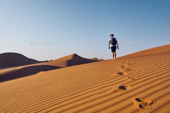 Tourist in desert - Stock Photo - Images