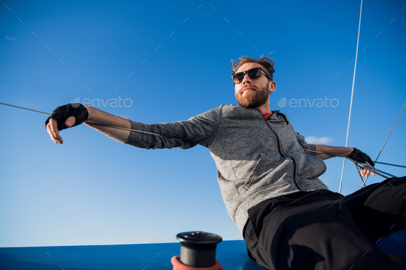 Handsome man resting On Yacht in the open sea on cruise - Stock Photo - Images