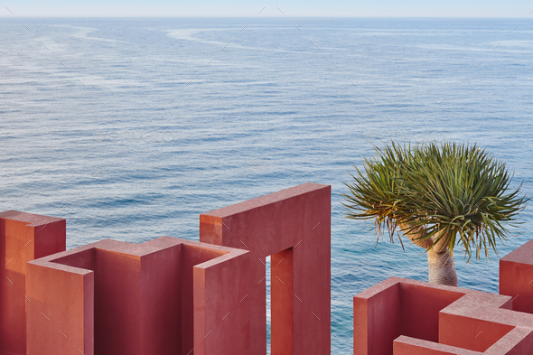 Geometric building construction. The red wall, La manzanera. Calpe, Spain - Stock Photo - Images