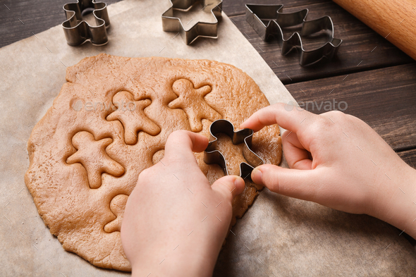 Child hands making festive Christmas gingerbread cookies - Stock Photo - Images