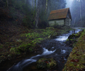 Small house stands on the banks of a mountain river - PhotoDune Item for Sale