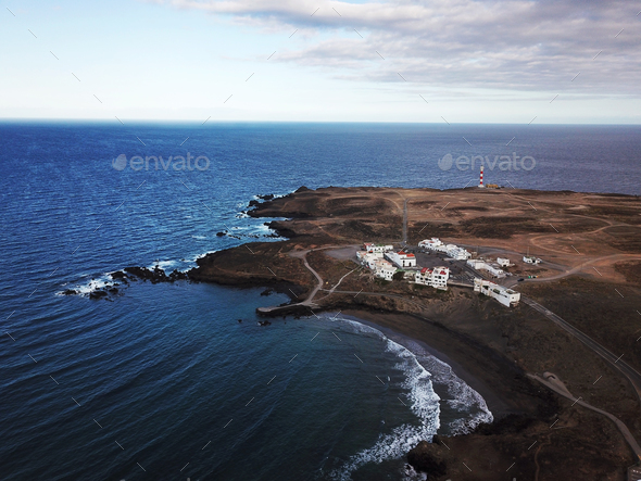 View from the height of rocky coastline with white buildings and - Stock Photo - Images