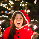 Holiday, Christmas and people concept - Young happy woman wearing Santa suit holding bengal light - PhotoDune Item for Sale