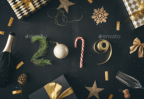 Baubles and gifts on black desk - Stock Photo - Images