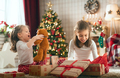 girls opening Christmas gifts - PhotoDune Item for Sale