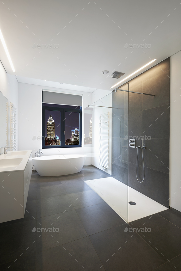 Bathtub in corian, Faucet and shower in tiled bathroom - Stock Photo - Images