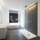 Bathtub in corian, Faucet and shower in tiled bathroom - PhotoDune Item for Sale