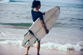 Surfer woman with surfboard the beach - PhotoDune Item for Sale