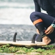 Surfer tying leg leash before surfing - PhotoDune Item for Sale